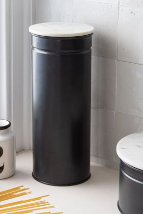 Lifestyle image of the Matt Black Steel Tall Spaghetti Canister With Marble Lid