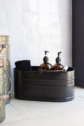 Lifestyle image of the Matt Black Steel Utility Bucket