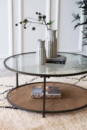 Lifestyle image of the Round Coffee Table With Metal Rattan Shelf