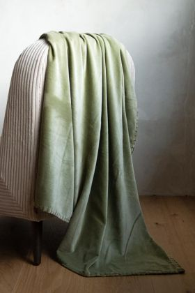 Lifestyle image of the Moss Green Velvet Throw