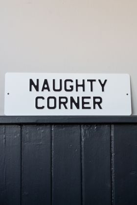 Front on image of the Naughty Corner Metal Sign Wall Art