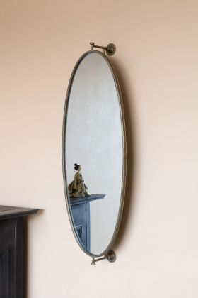 Lifestyle image of the Oval Swivel Wall Mirror