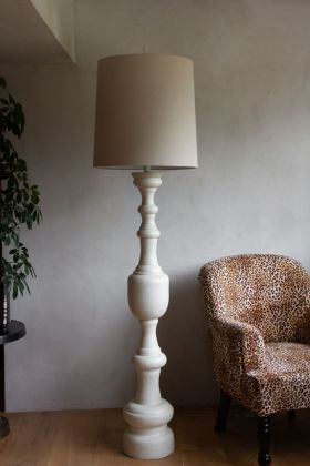 Lifestyle image of the Giant Traditional Style Floor Lamp in Cream