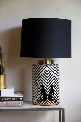 Lifestyle image of the Pair Of Panthers Chevron Table Lamp With Black Shade
