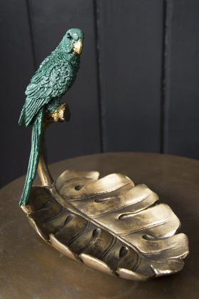Lifestyle image of the Emerald Green Parrot Perched On A Leaf Ornament