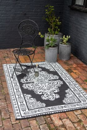 Image of the darker side of the Persian-Style Reversible Outdoor Garden Rug