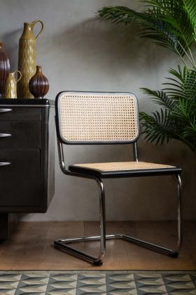 Lifestyle image of the Retro Chrome & Woven Cane Dining Chair
