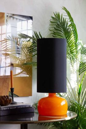 Lifestyle image of the Retro Seventies Orange Table Lamp With Shade