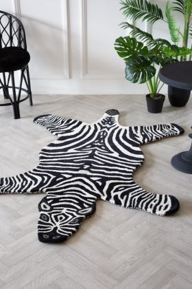 Lifestyle image of the Large Hand-Tufted Wool Zebra Rug