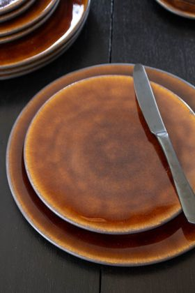 Image of the Roda Mustard Stoneware Side Plate on top of the matching dinner plate