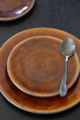 Image of the Roda Mustard Stoneware Small Side Plate on top of the standard side plate