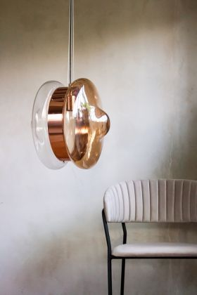 Lifestyle image of the Rose Gold Ceiling Light With Amber Illumination