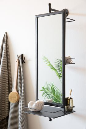 Lifestyle image of the Rotating Wall Mirror With Shelves Behind