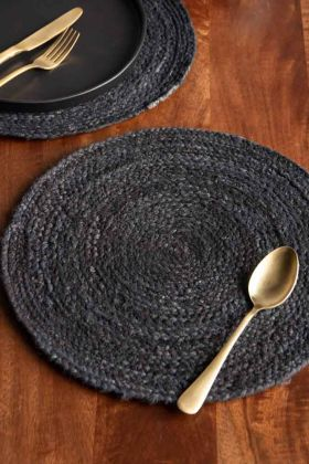 Close-up lifestyle image of the Round Black Jute Placemat