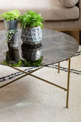 Close-up lifestyle image of the Round Coffee Table With Bronze Oxidised Mirrored Top