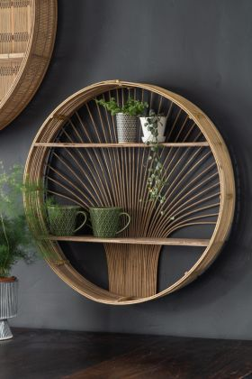 Lifestyle image of the Round Rattan Shelf hung on the wall