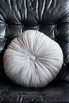 Image of the front of the Round Ruched Grey Cushion With Central Button