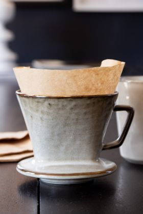 Image of the Sand Dunes Stoneware Coffee Funnel with filter papers in it