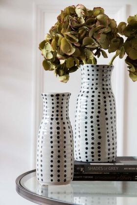 Lifestyle image of the short and tall Black Spotted Vases