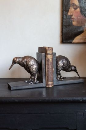 Lifestyle image of the Set Of 2 Bronze Effect Bird Bookends
