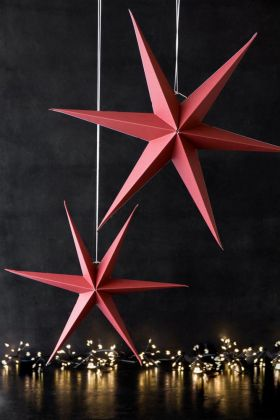 Lifestyle image of the Set Of 2 Red Paper Star Hanging Decoration