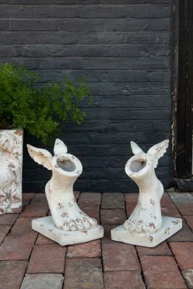 Lifestyle image of the Set Of 2 Rustic Stone Effect Winged Foot Planters