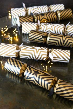 Lifestyle image of the Set Of 6 Two-Tone Gold Star Luxury Christmas Crackers