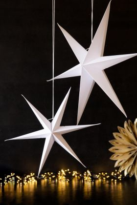 Festive lifestyle image of the Set Of 2 White Paper Star Hanging Decoration