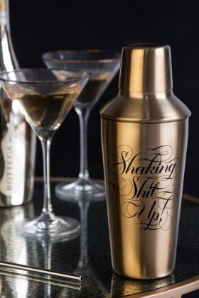 Lifestyle image of the Shaking Shit Up! Gold Cocktail Shaker