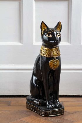 Image of the Egyptian Sphinx Inspired Sitting Cat Ornament in front of a door