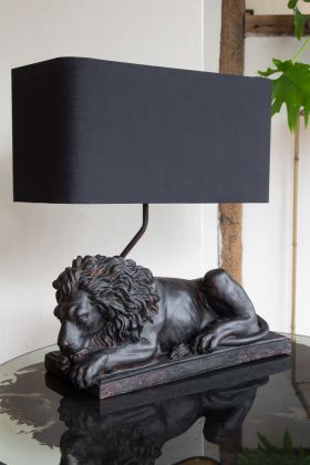 Angled image of the Sleeping Lion Table Lamp With Lamp Shade