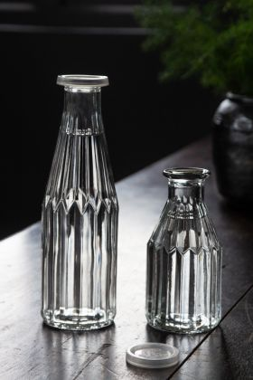 Image of both the large & small Beautiful Glass Storage Bottle With Plastic Lid