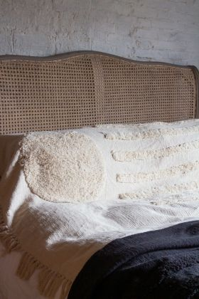 Lifestyle image of the Ivory Cream Soft Cotton Tufted Stripes & Dot Throw on a bed