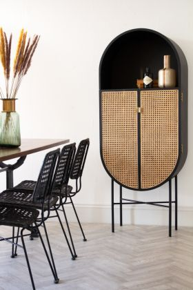 Lifestyle image of the Black Sungkai Woven Cane & Mango Wood Oval Cabinet
