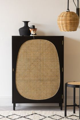 Front on lifestyle image of the Black Sungkai Woven Cane & Mango Wood Single Door Cabinet