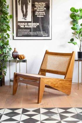 Lifestyle image of the Teak Wood & Woven Cane Lounge Chair
