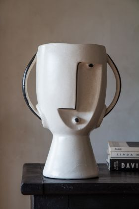 Front on image of the Monochrome Abstract Face Urn Vase