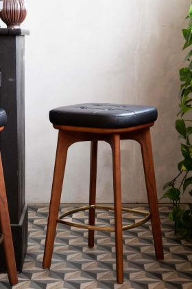 Lifestyle image of the Timeless Mid-Century Style Bar Stool In Walnut & Black