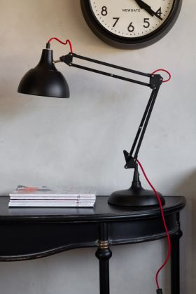 Lifestyle image of the Retro Black Desk Lamp With Red Flex Accent