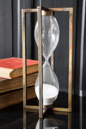 Image of the Traditional Sand Timer In A Metal Frame