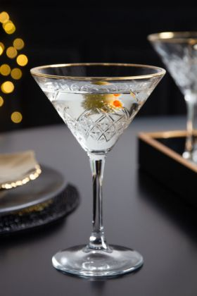 Lifestyle image of the Vintage Cut Glass Martini Glass With Gold Rim