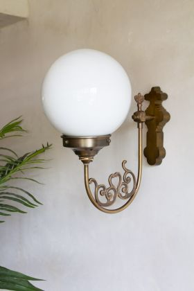 Image of the Vintage-Style Globe Wall Light on a light background