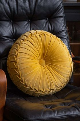 Lifestyle image of the Vintage Style Velvet Ruched Round Cushion - Mustard