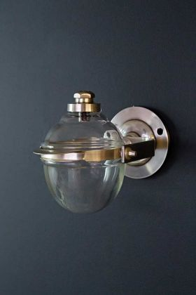 Image of the Glass Wall Mounted Soap Dispenser attached to a wall facing upwards