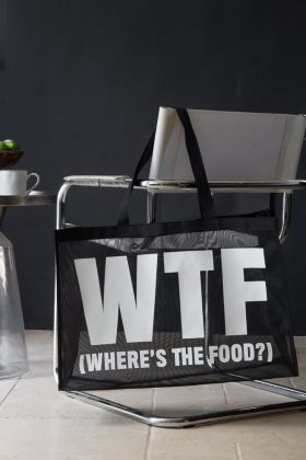 Image of the wtf(where's the food?) large shopper bag on grey chair with dark wall background