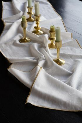 Close-up lifestyle image of the White Cotton Table Runner With Gold Trim