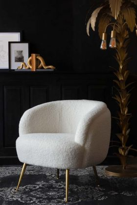 Lifestyle image of the White Teddy Armchair With Gold Legs