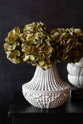 Lifestyle image of the White Bead Effect Chandelier Vase with faux stems