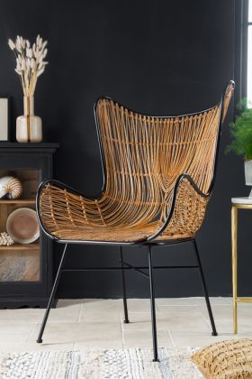 Lifestyle Image of the Woven Butterfly Frame Armchair