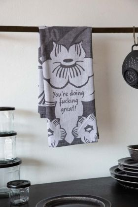 Lifestyle image of the You're Doing Fucking Great Typography Tea Towel with Floral Design